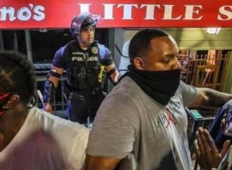 Black men form human shield to protect police officer during protest
