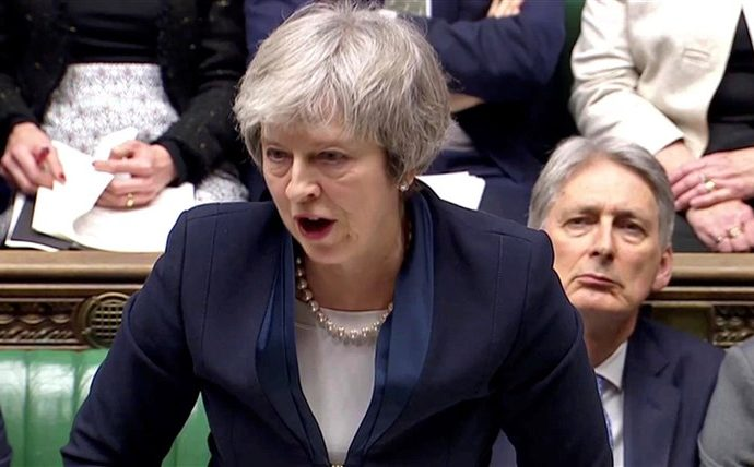 Theresa May's Brexit deal crushed in parliamentary vote
